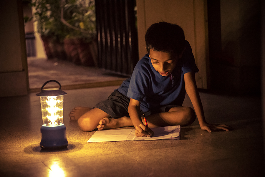 boy writing during power outage